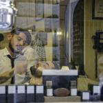 A view through the window of the barber shop in Monti