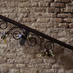 Locks attached to a metal railing at Salita dei Borgia