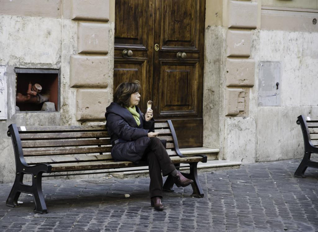 Woman eating gelato on the bench in Jewish Ghetto